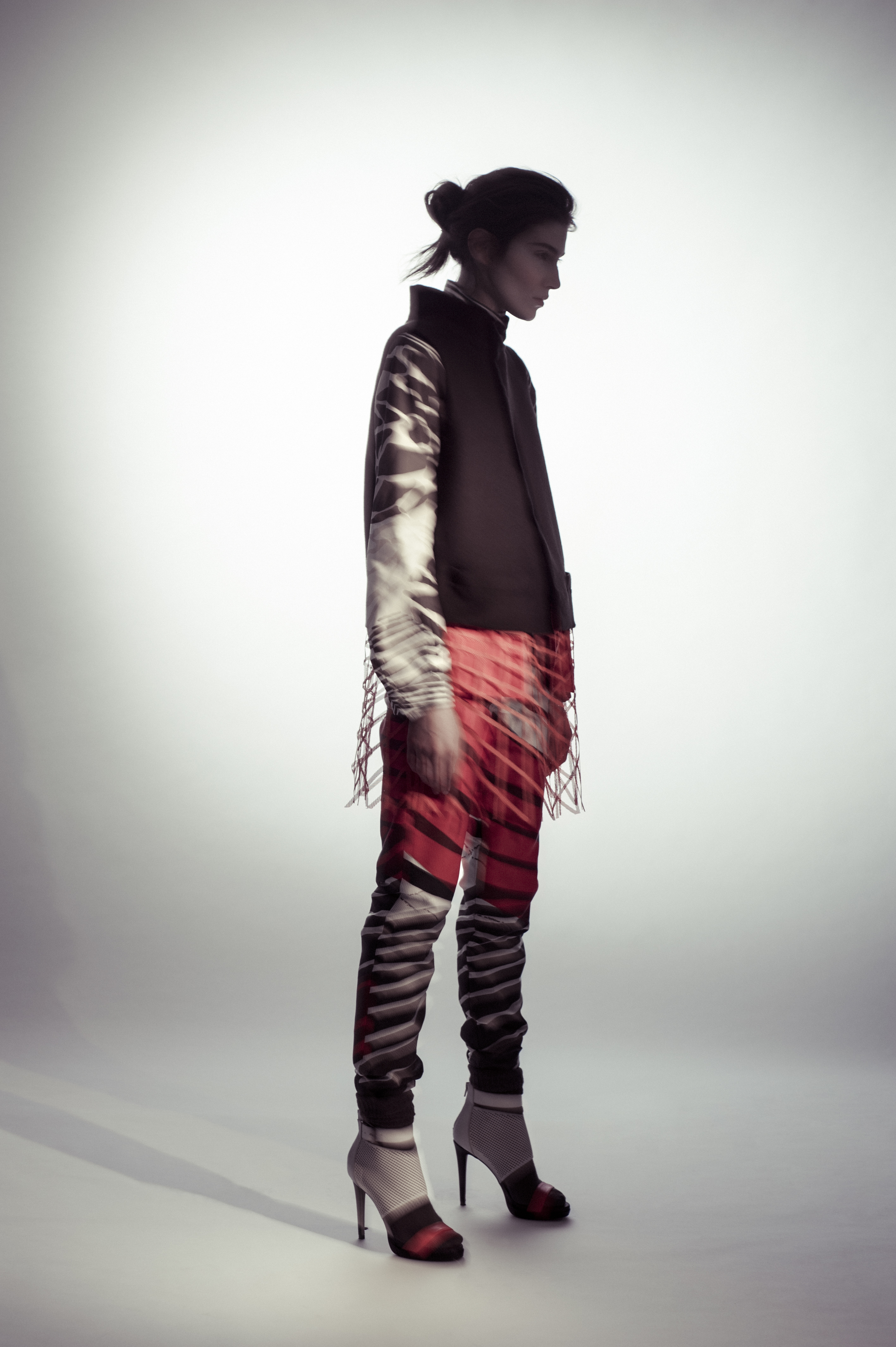 Vest, shirt, and pants by Ernest Huang, MFA Fashion Design and Hong Ni, MFA Textile Design. Socks, stylist's own. Shoes, Aldo.