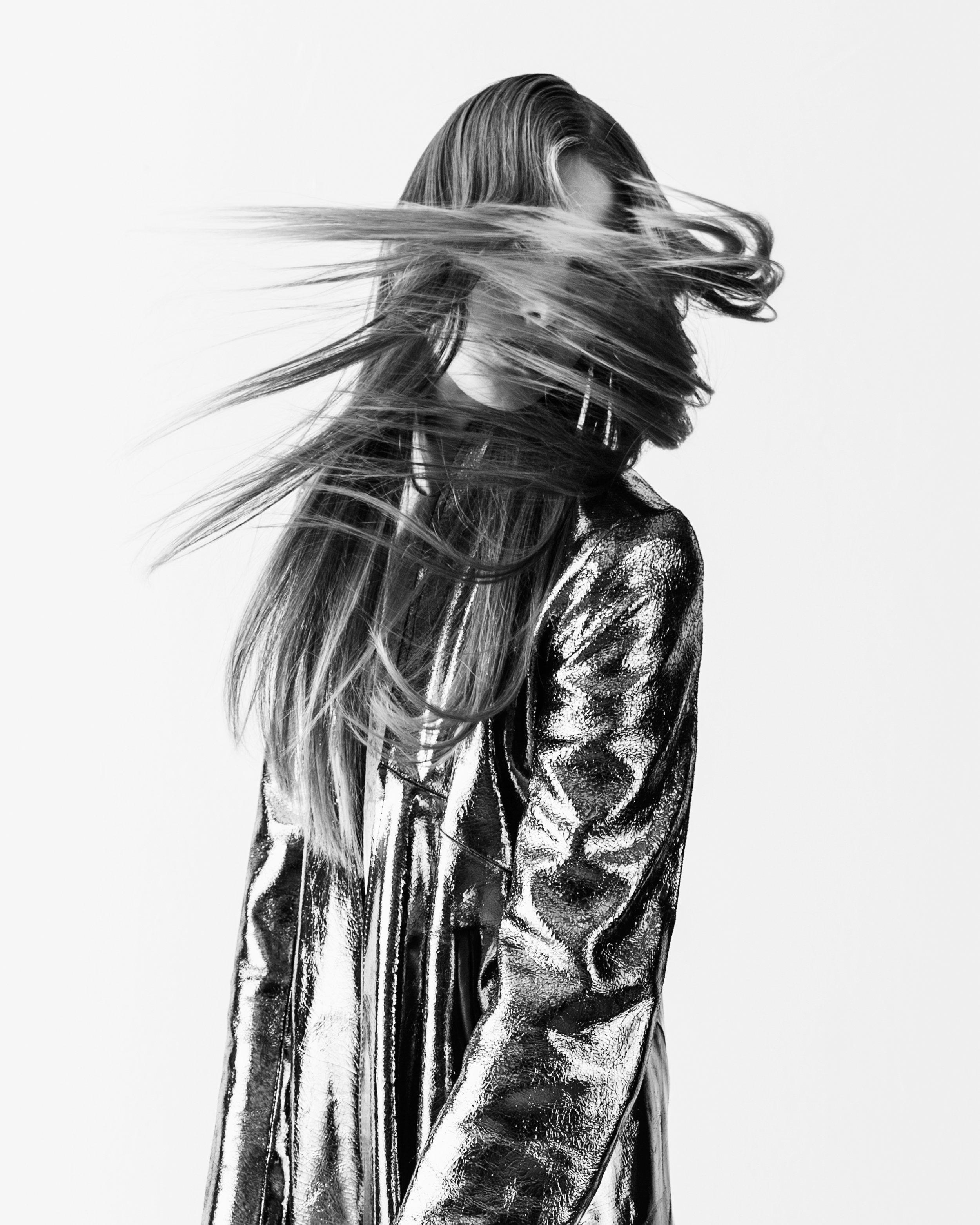 Coat by André Torija, BFA Fashion Design. Dress by Jason Tam, MFA Fashion Design.