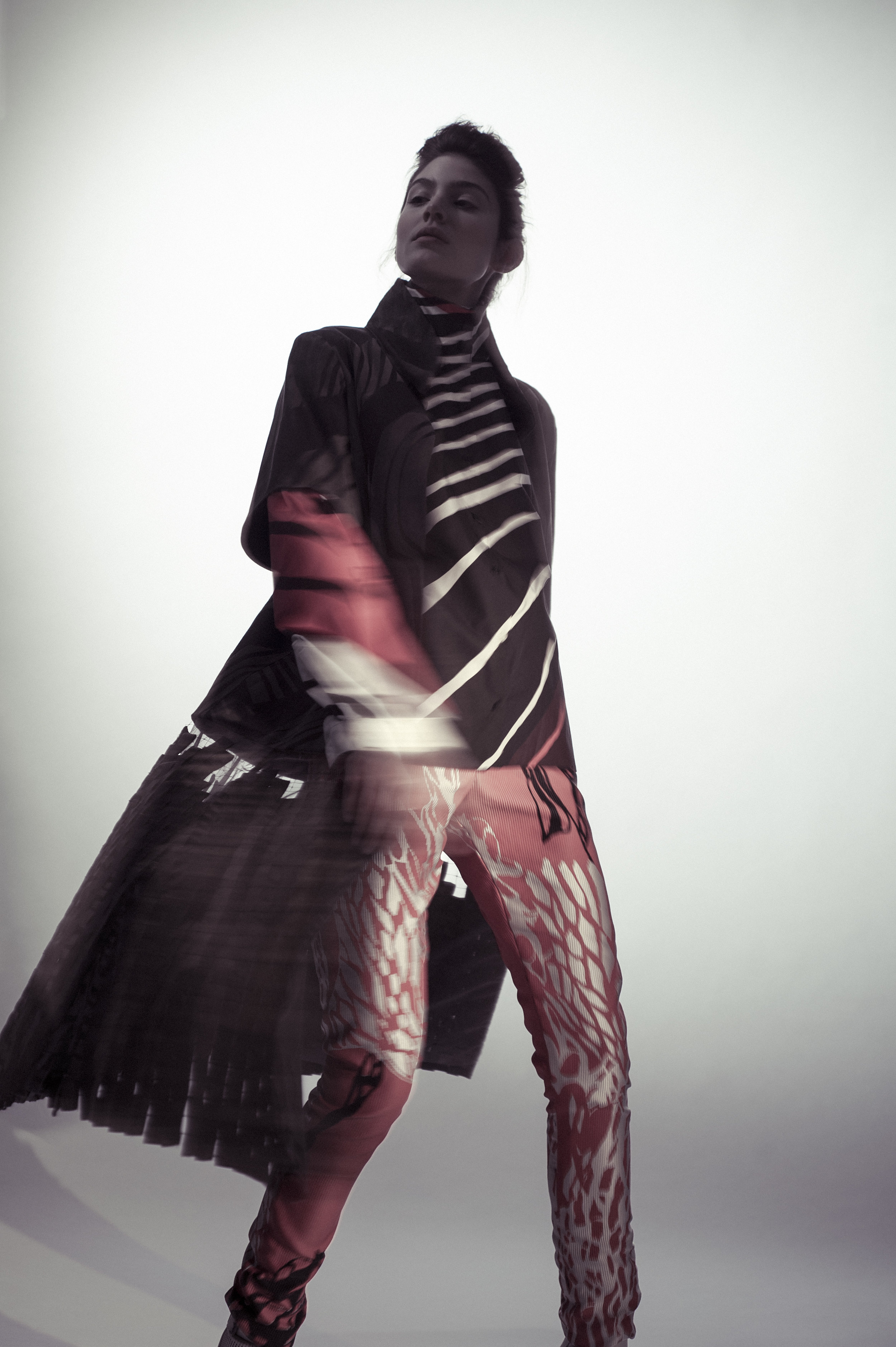 Printed and Woven Coat, Shirt, and Pants by Ernest Huang, MFA Fashion Design and Hong Ni, MFA Textile Design. Socks, stylist's own. Shoes, Aldo.