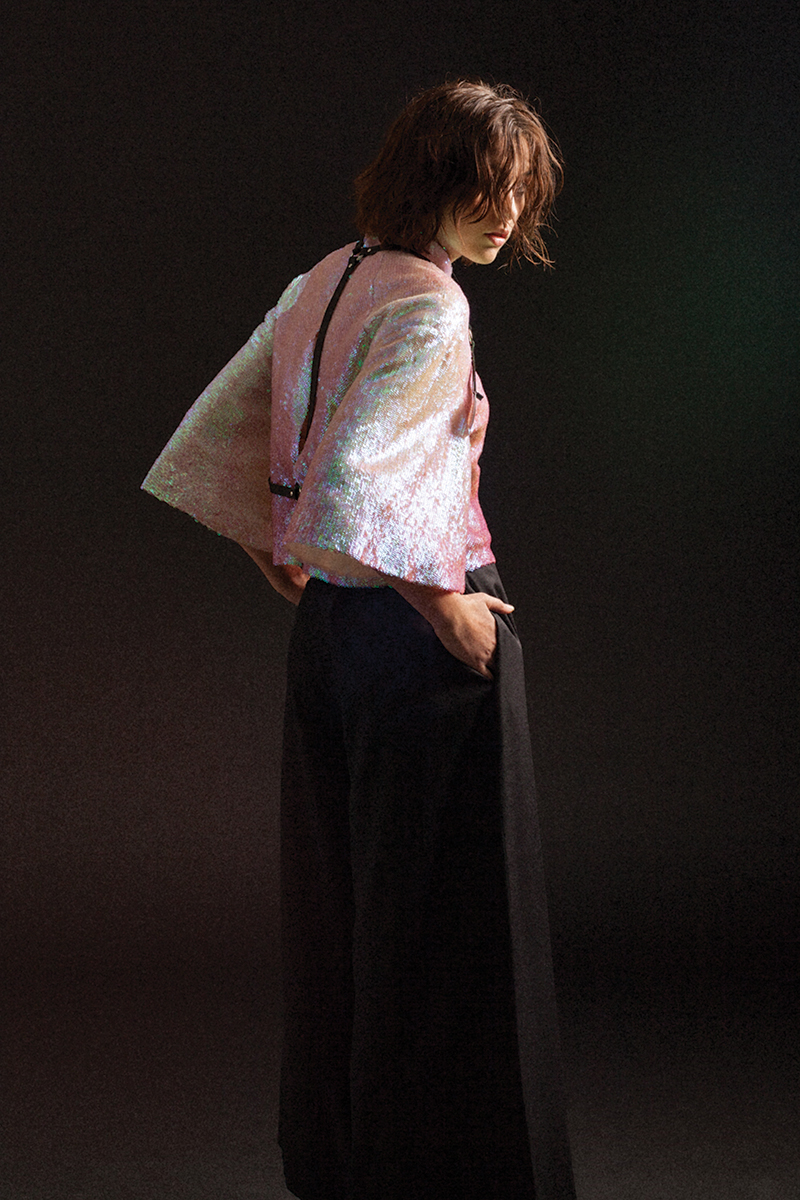 Sequin Top by Max Lu and Jingci Jessie Wang, MFA Fashion Design. Black Dress by Wenhan Yuan, MFA Fashion Design. Harness, stylist's own.