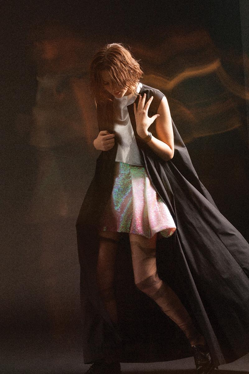 Top and Shirt by Max Lu and Jingci Jessie Wang, MFA Fashion Design. Black Dress by Wenhan Yuan, MFA Fashion Design. Stockings and Shoes, stylist's own.