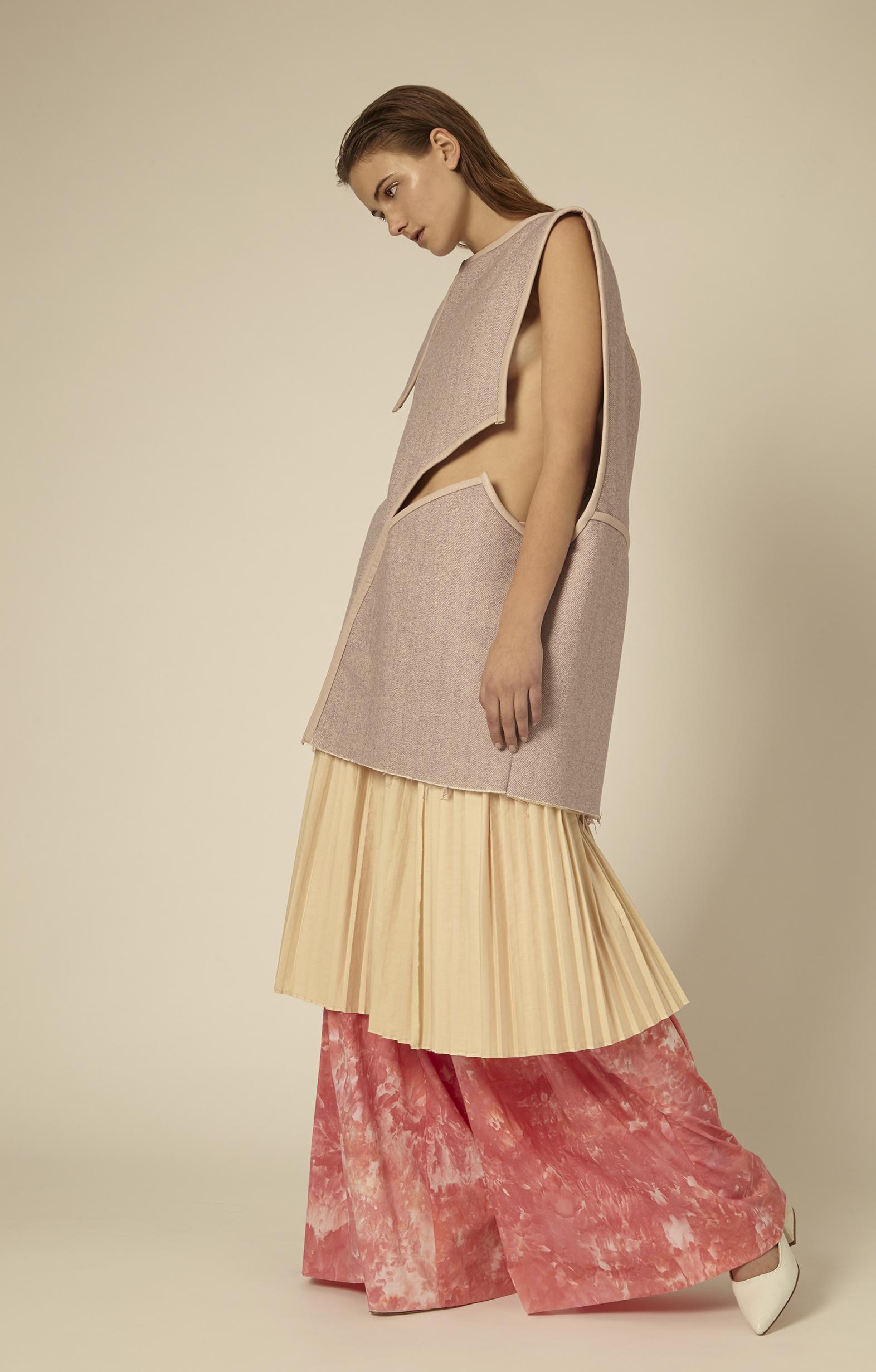 Top by Lucky Yijia Jiang, MFA Menswear Design. Skirt by Ruone Yan, BFA Menswear Design. Pants by Dominic Tan, BFA Menswear Design. Shoes, stylist's own.