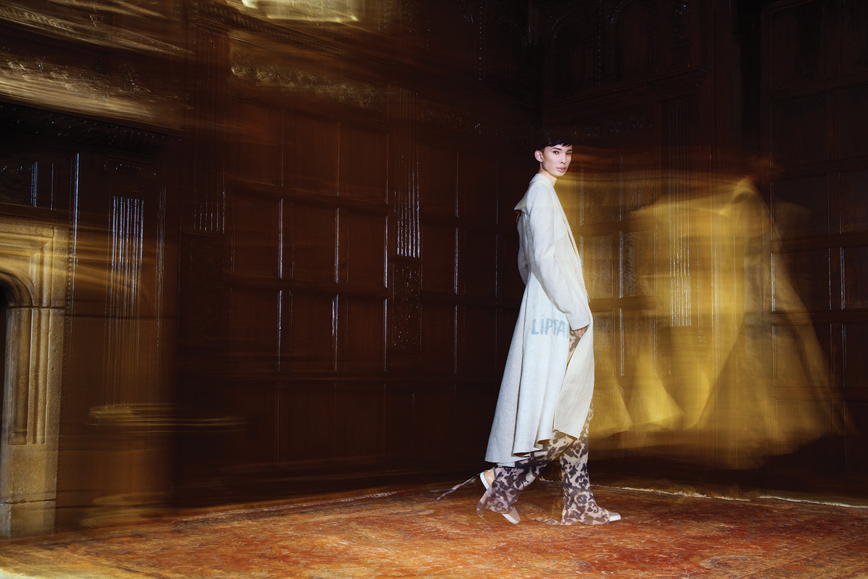Top and Pants by Justin Moreno, BFA Menswear Design. Coat by Lindsey Truman, MFA Fashion Design. Slip-on sneakers, UGG.