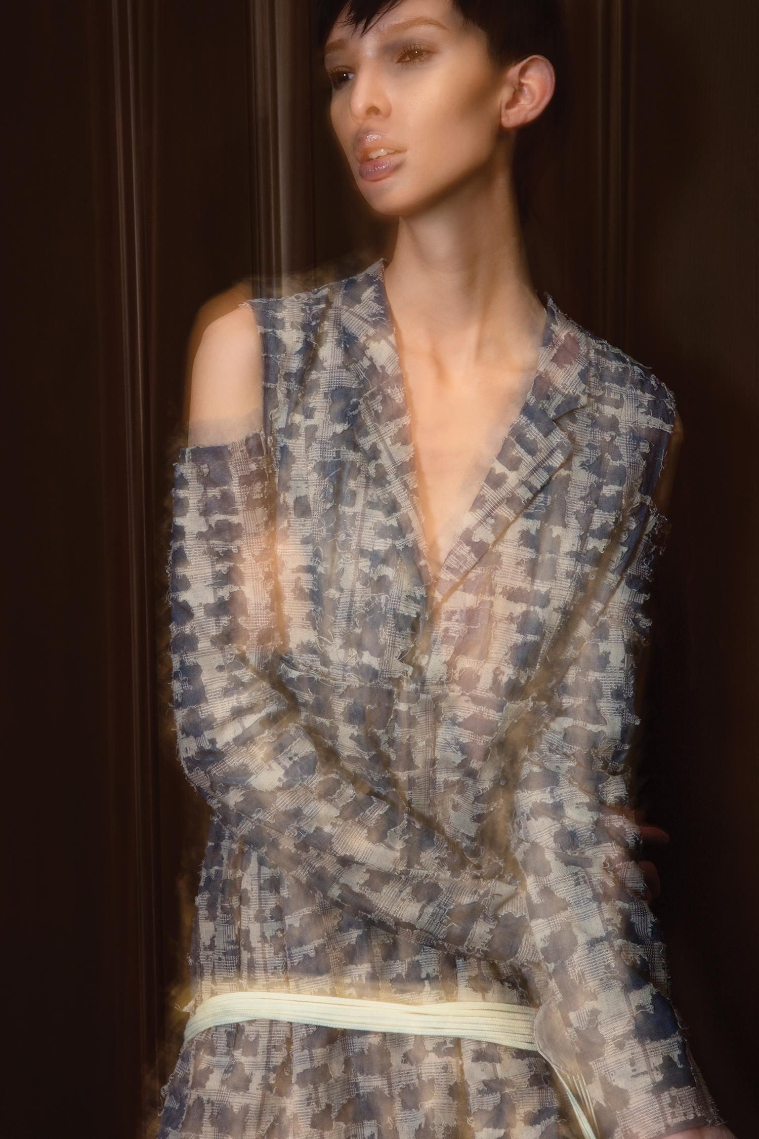 Jumpsuit by Dora Li, MFA Fashion Design. Suspenders used as belt by Brandon Kee, BFA Menswear Design.