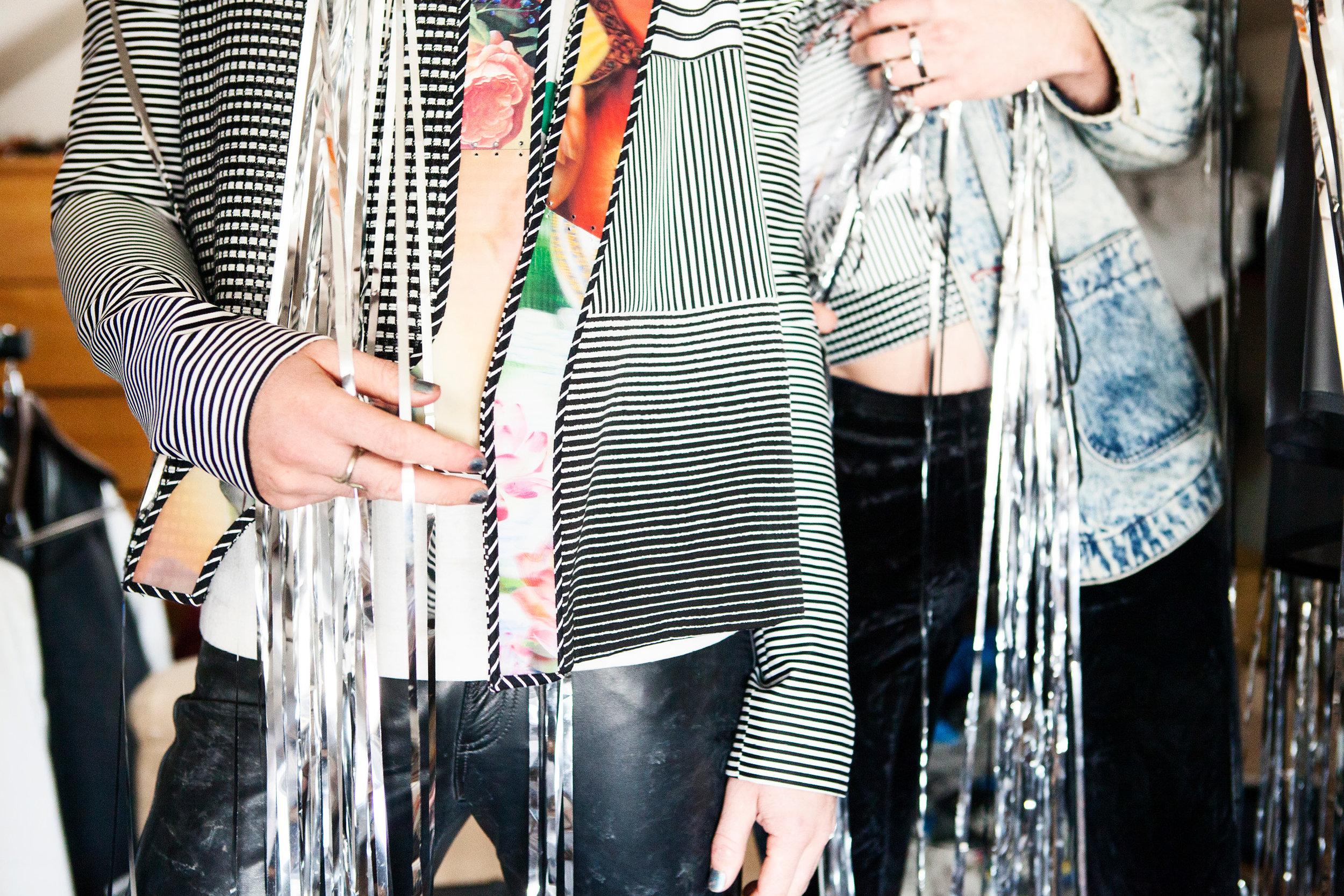 on Nathaniel: Jacket by Gaia Giladi, BFA Fashion Design. Pants and t-shirt, band's own. on Nick: Shirt by Gaia Giladi, BFA Fashion Design. Jacket, band's own. Pants by Cherng-Hann Lee, BFA Menswear Design.