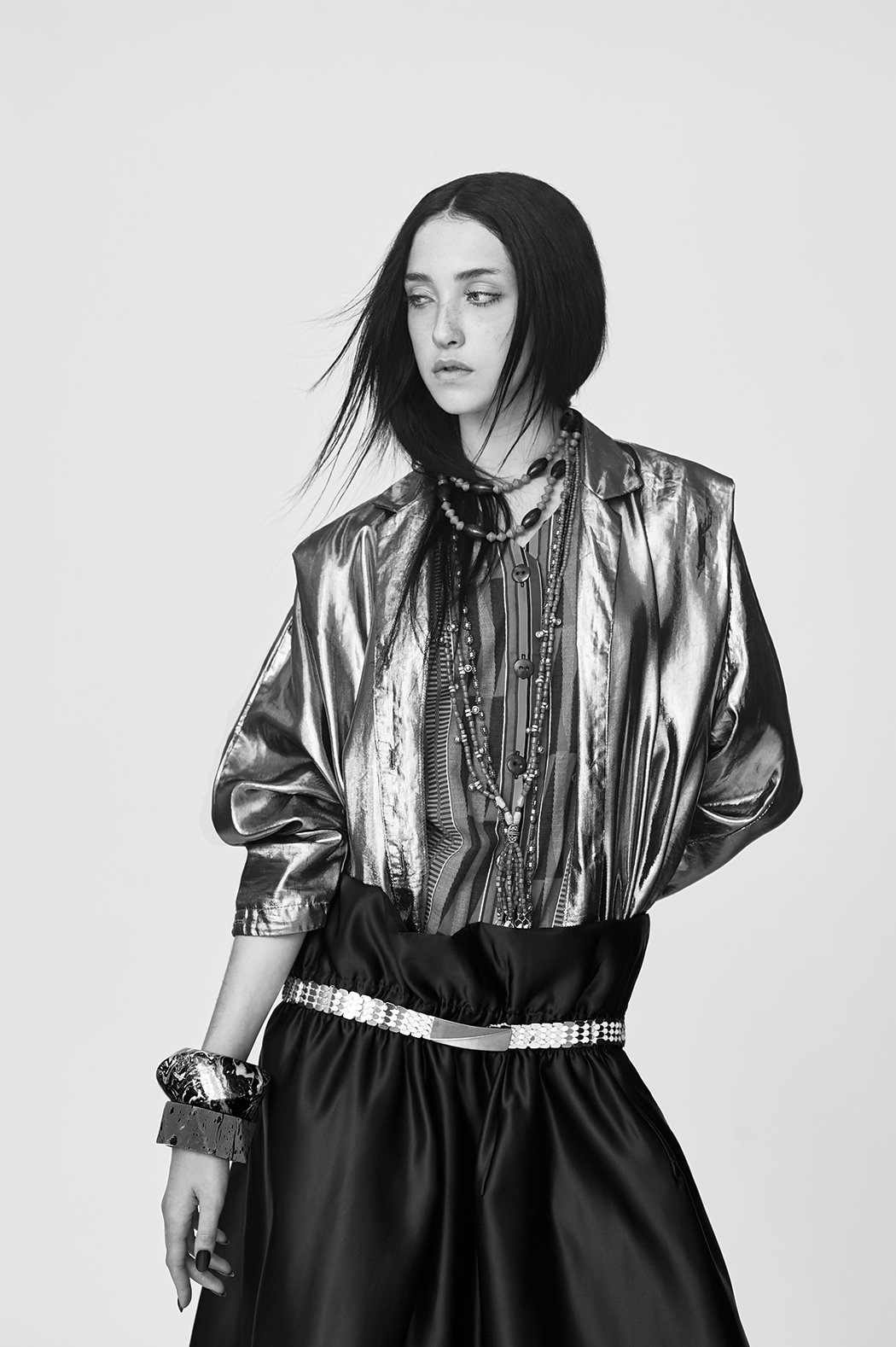 Skirt by Jiaqi Lu, BFA Fashion Design. Vintage Metallic Jacket, Vintage African Jumpsuit, and Belt. All jewelry, stylist's own.