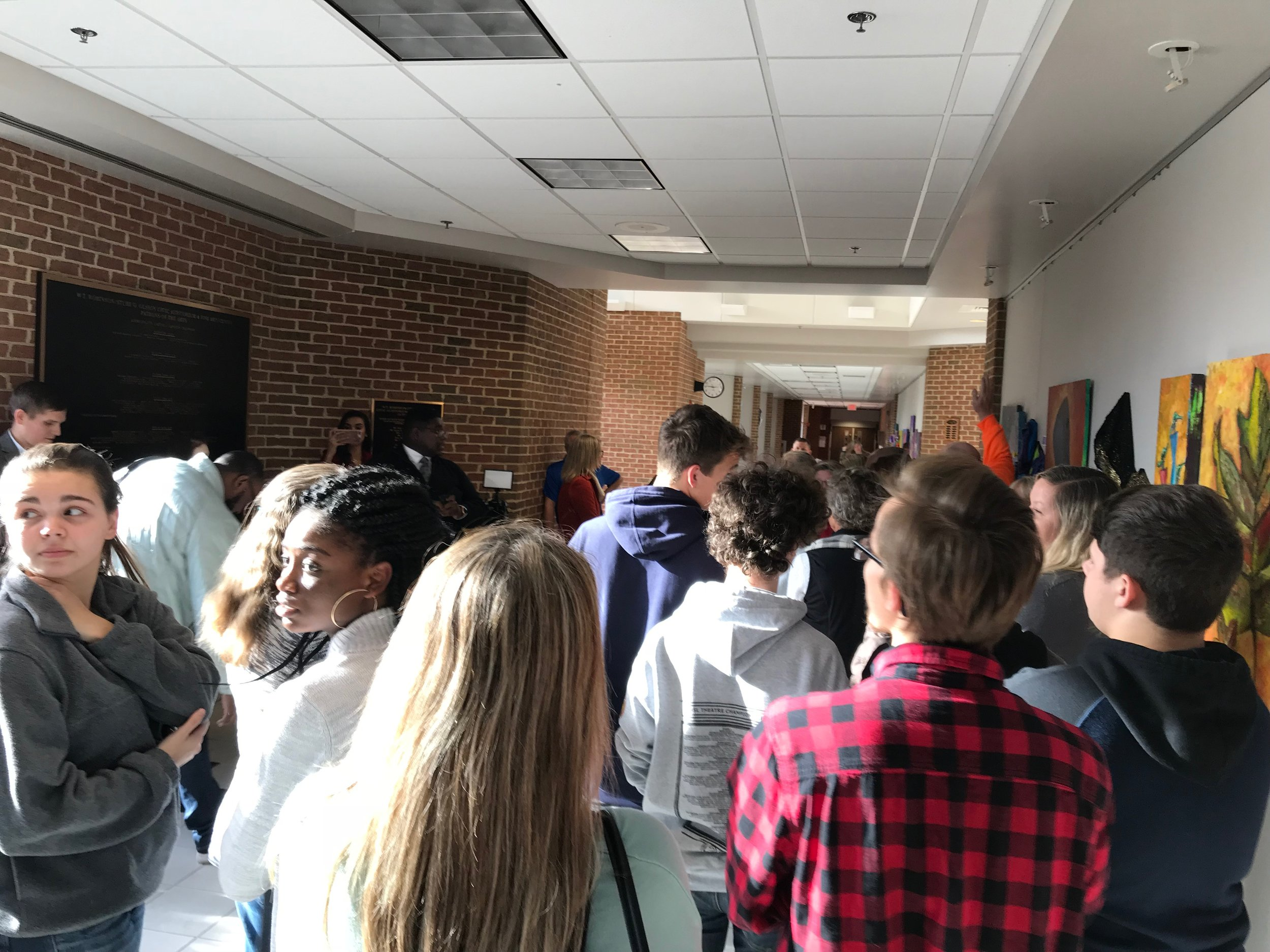 Students waiting in the hallway, hoping to show support for Mr. Vlaming. Only a handful were able to enter the room.