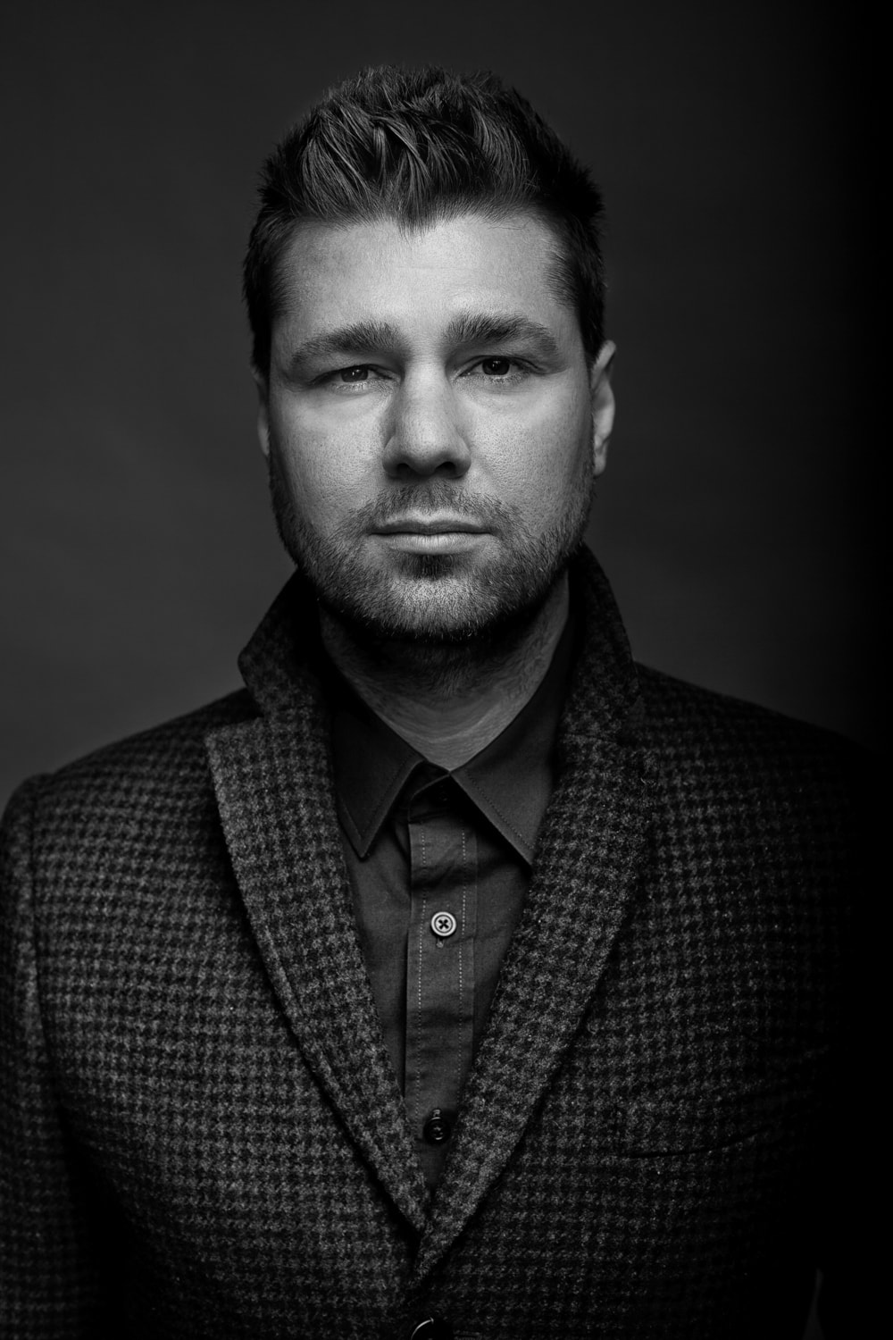 Headshot Photography of Male Client in Black & White Taken By the Professional Headshot Photographers at Harper Point.