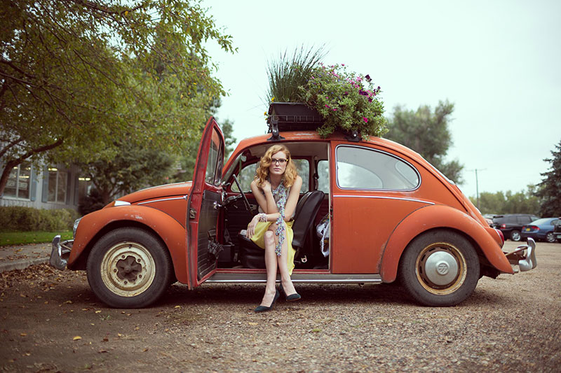 Commercial Photography in Camarillo of Woman Sitting in Old Volkswagen Beetle Taken by Harper Point