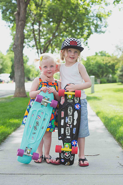 Photographer in Camarillo taking picture of children with skateboards on the sidewalk