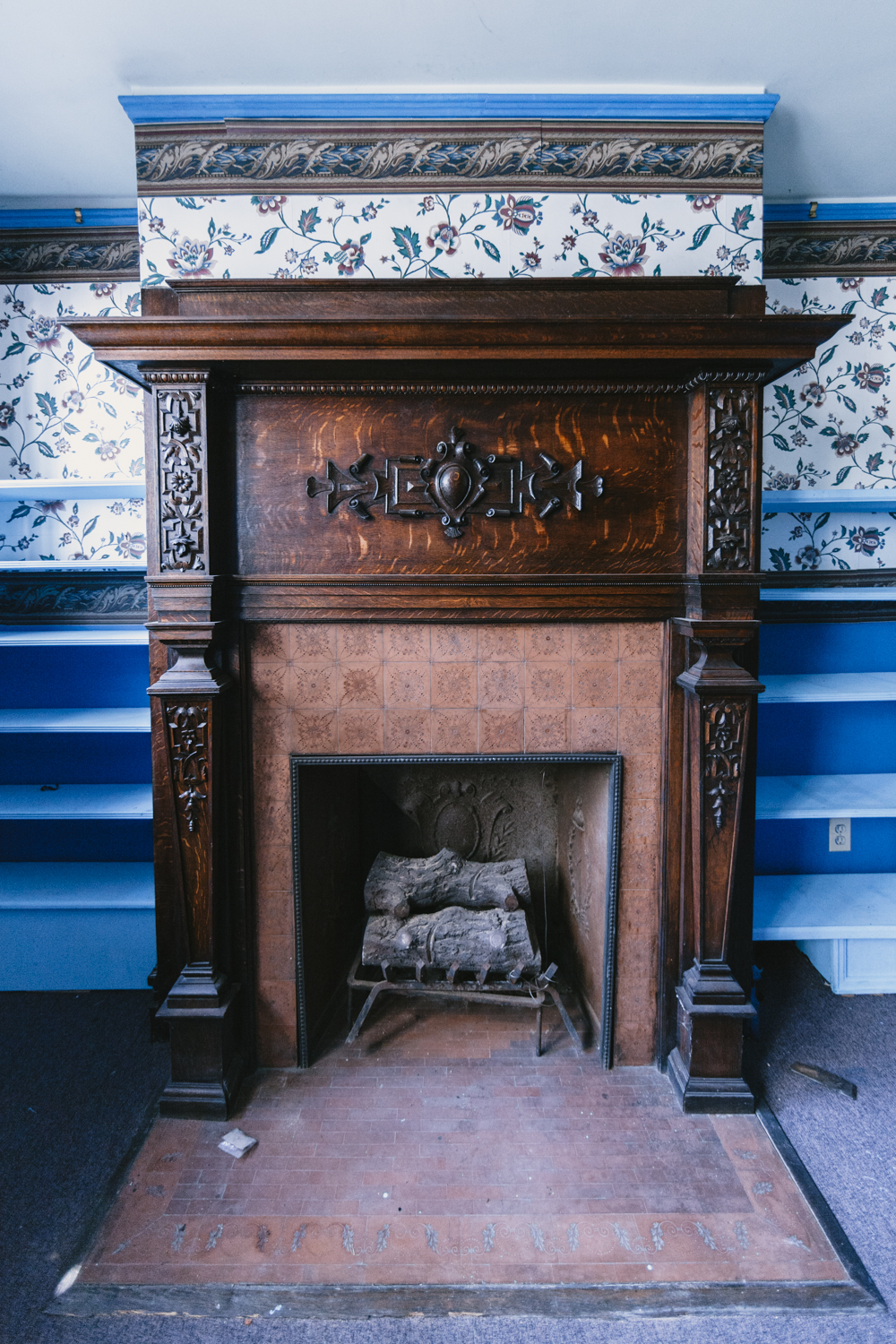 Terra Cotta tiles on under stair card room fireplace surround