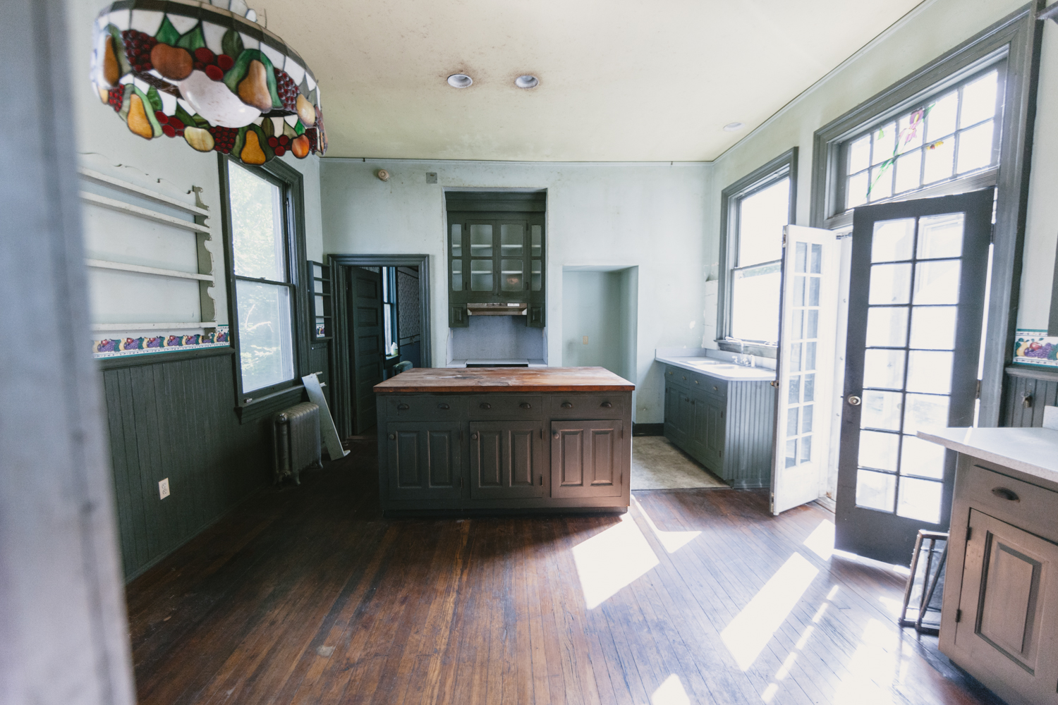 The kitchen features an historic island, once used as a lab table in Randolph Macon Womens college and opens up onto the back porch.