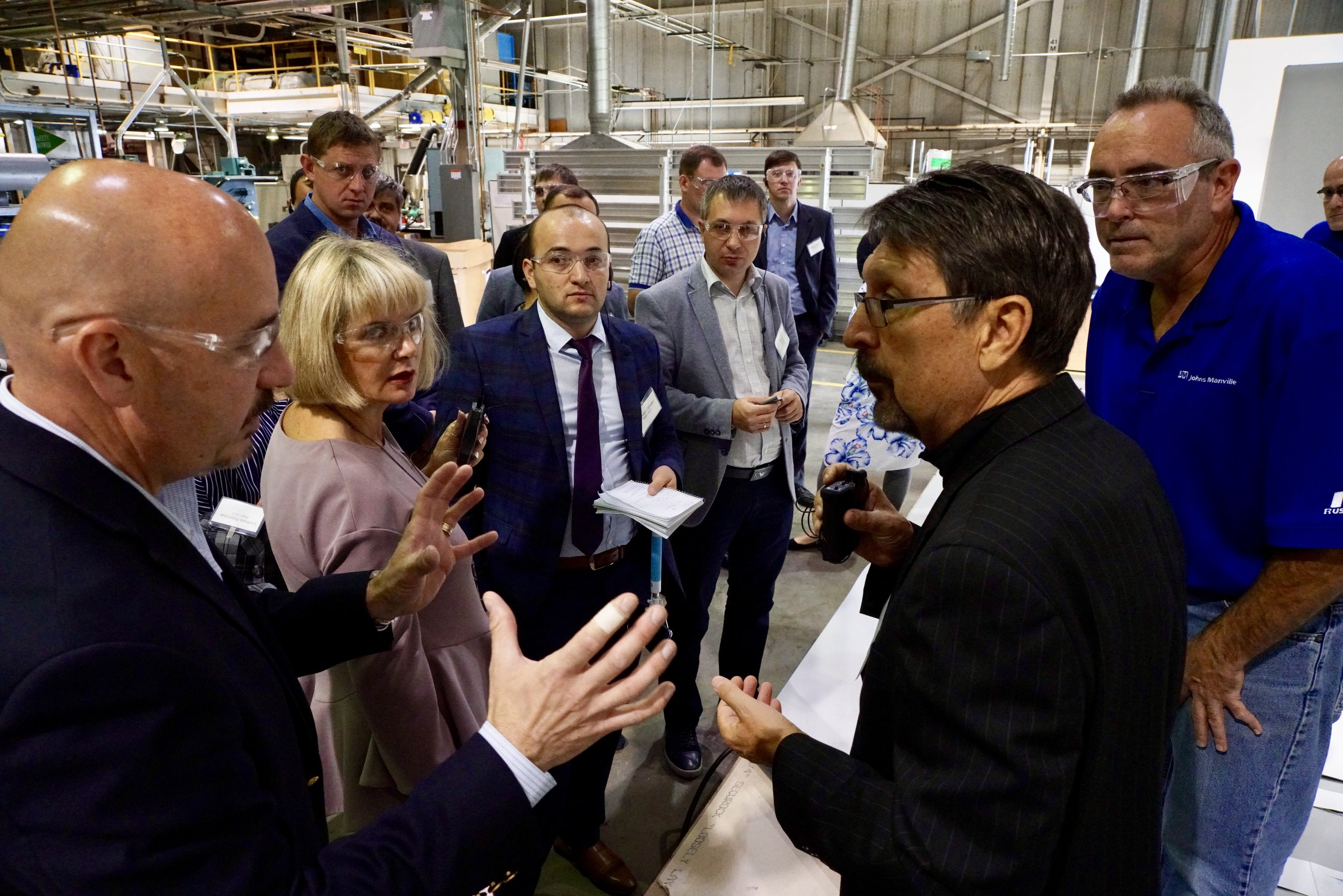 Markian Duma (L) fields questions from Eurasian business leaders as part of the Special American Business Internship Training (SABIT) program through the U.S. Dept. of Commerce.