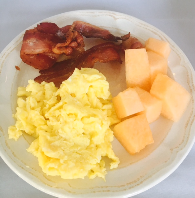 Farm fresh scrambled eggs, organic uncured bacon and fruit of choice