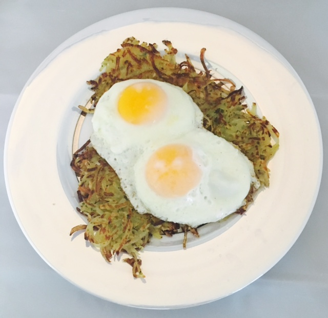 Eggs over easy with homemade   potato fritters