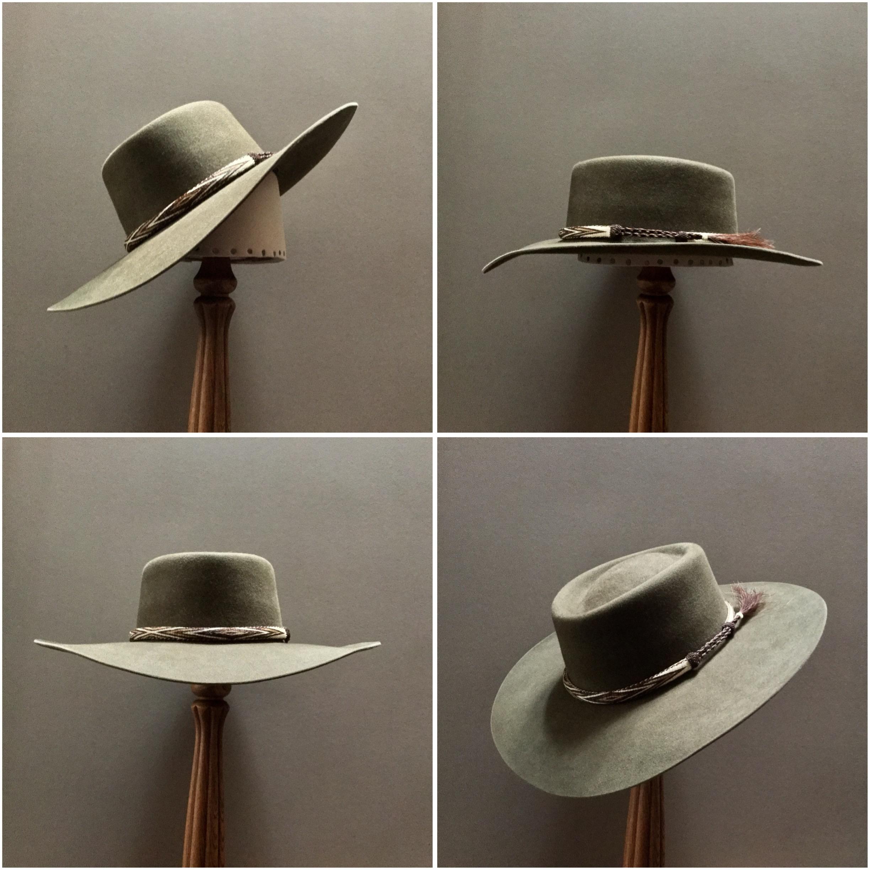 Material: 100% Beaver Color: Olive Drab Brim Set: Naturalist, Wide Drop Front, Contour Brim Trim: Hitched Horsehair