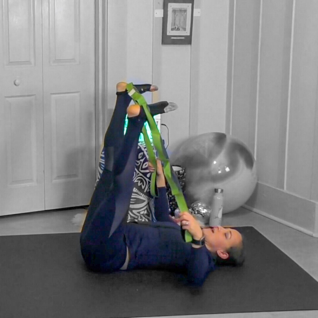 double hamstring stretch with loop strap jessi fit pilates