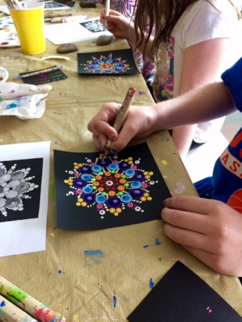 Grade 5 students dot the  Canada 150  mandala.