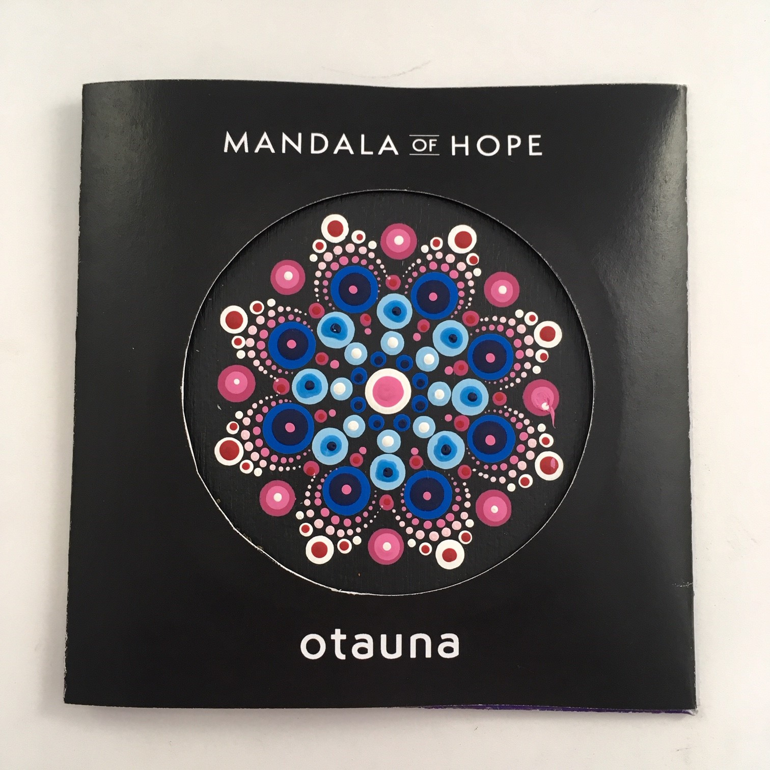 In the  LOVE is all we need  mandala, the blue dots represent a difficult time in one's life. The pink dots encircle the blue, symbolizing the love that surrounds us when we need it most.