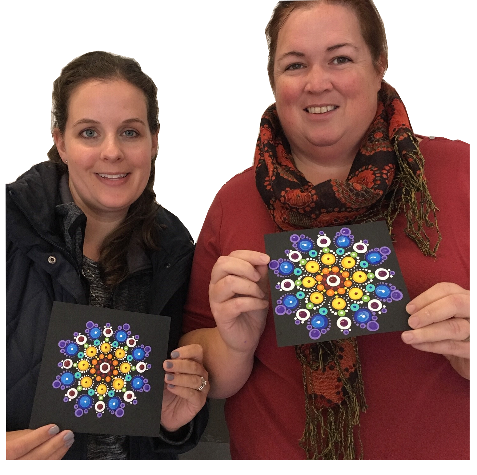 After completing their first class with Ginger, beginners proudly display their Rainbow Mandala.
