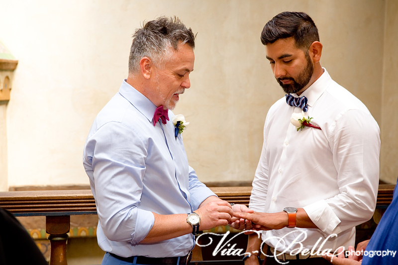santa barbara courthouse gay wedding grooms exchanging rings
