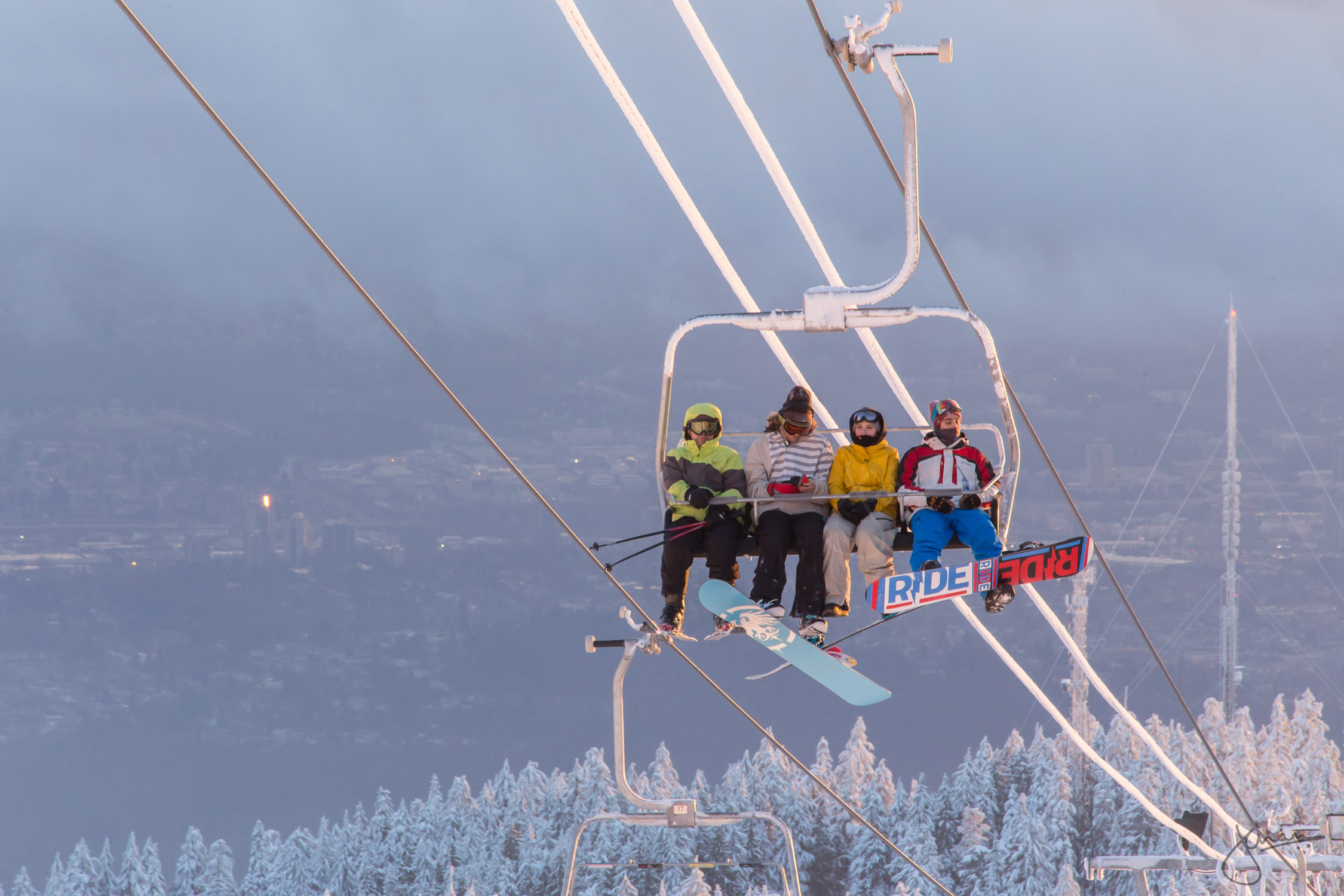 Boarders heading up the chairlift