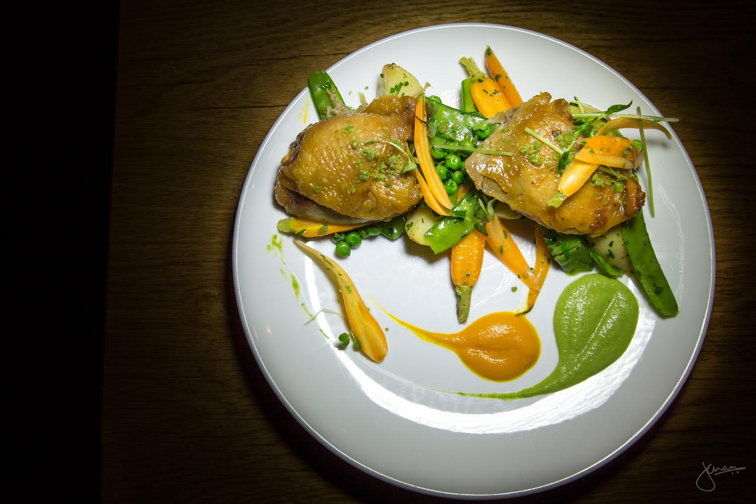 Maple Hill Farms Confit Chicken Thighs - Roasted new potatoes, glazed local baby carrots, english peas, snow peas & wasabi pea dust