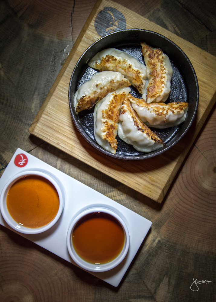 Pork Teppan Gyoza - served with spicy miso _ umami soy