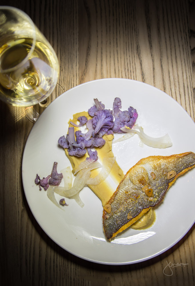 Pan-seared Branzino paired with Tolloy Pinot Grigio - purple cauliflower, fagioli purée, roasted garlic chips, pickled fennel