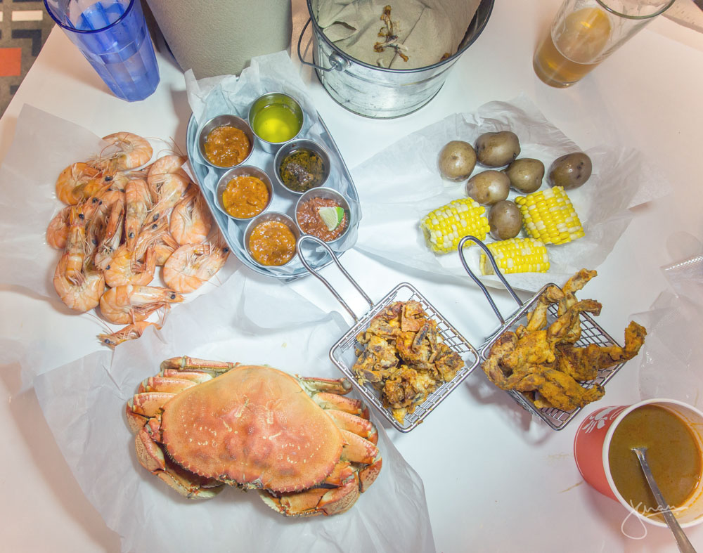 Dungeness Crab, Shrimps, variety of sauces, Nugget Potatoes, Corn, Deep Fried Soft Shell Crab, Deep Fried Frog Legs & Lobster Bisque