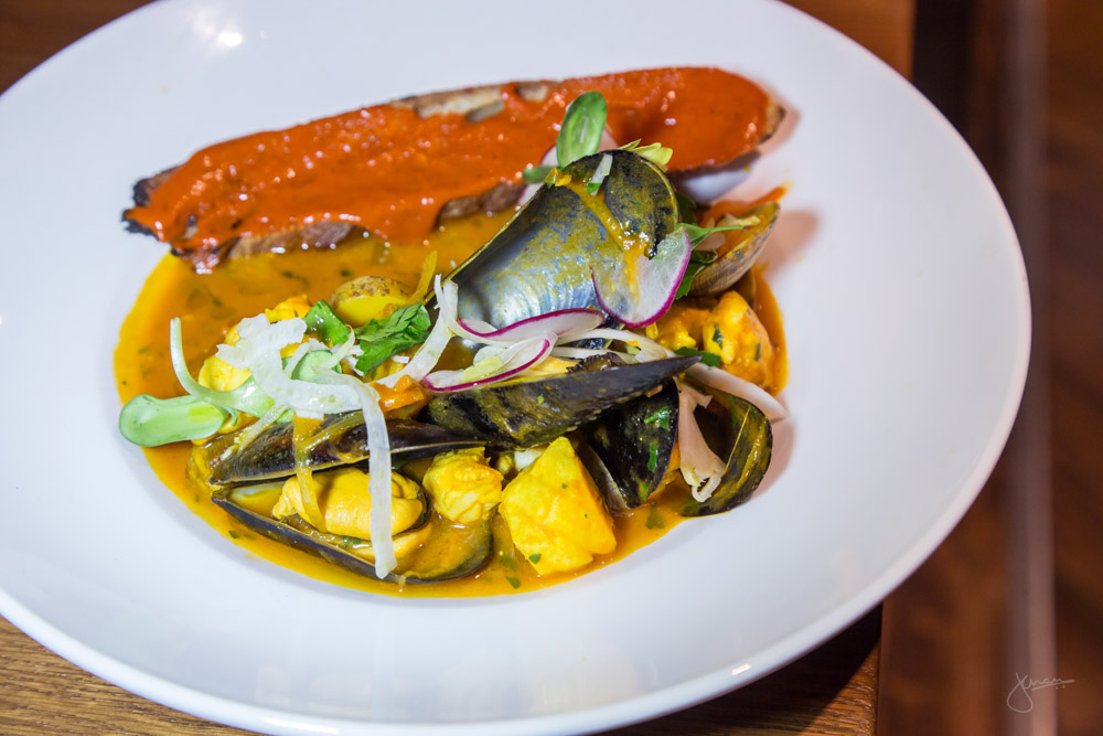 Northwest Bouillabaisse - fish, clams, mussels, tomato saffron broth, preserved lemon, grilled bread