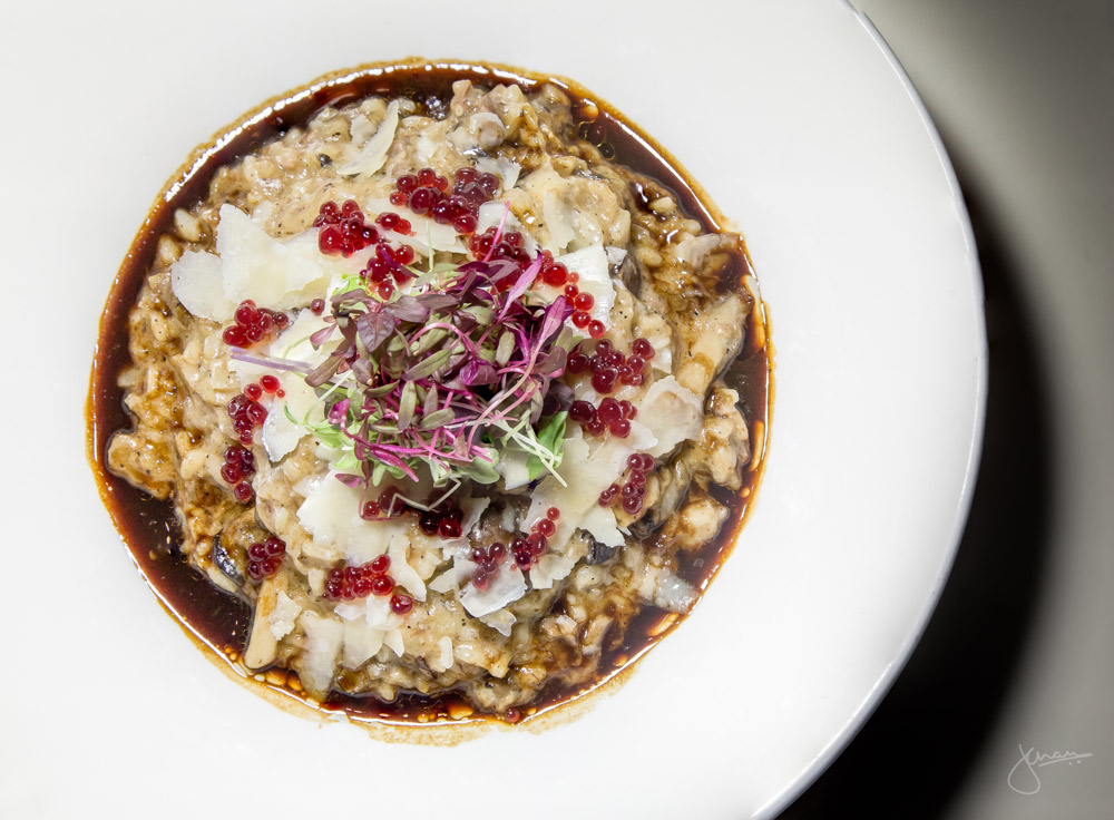 Oxtail and Foraged Mushroom Risotto: Red wine pomegranate reduction