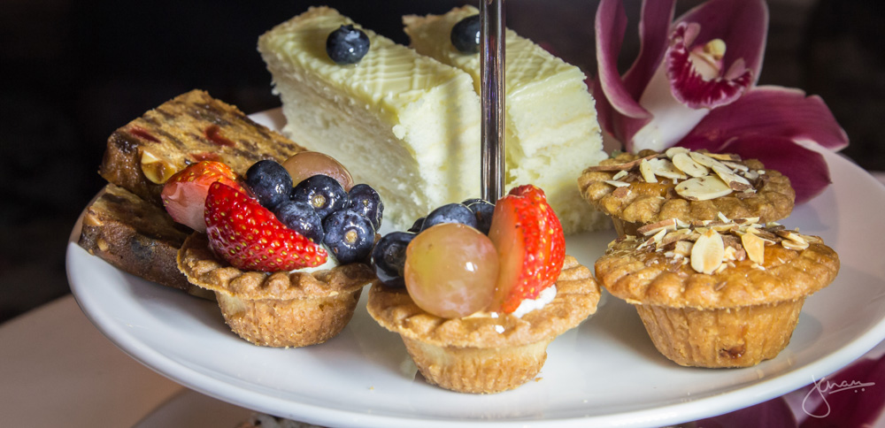 Tier 2: Mini Bakewell Tart, Seasonal Fruit Tartlet, English Fruit Cake, Lemon Chiffon with White Chocolate Ganache