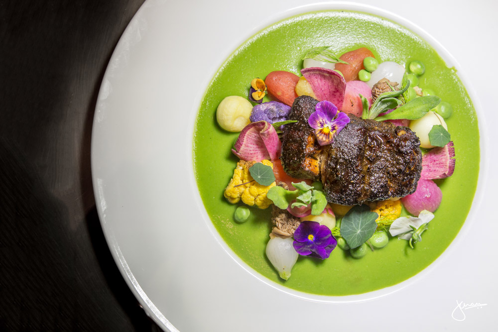 Lingcod - lavender honey ash crusted, green pea & nasturtium veloute, spring vegetables, meadow flowers
