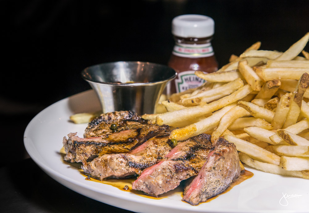Steak Frites - California cut striploin, shoestring fries, pepper jus house steak sauce