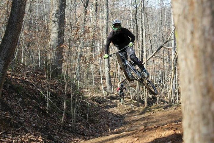 Mystery Rider popping off a small feature at Windrock