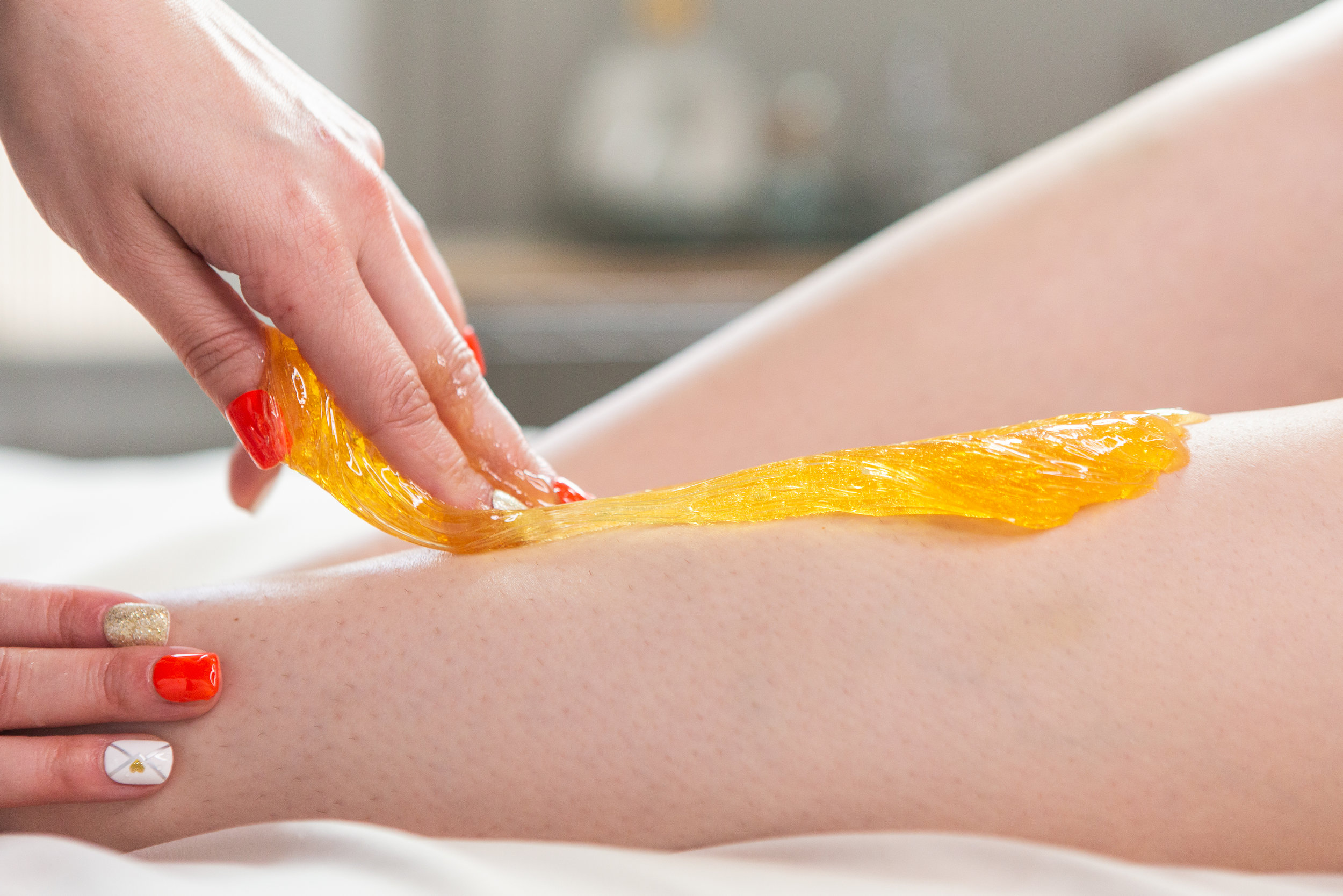 What is Sugar Hair Removal? - A technique that ancient middle-eastern ancestors would practice. The organic hair removal paste is derived from ingredients like sugar, water and lemon juice with results that can last up to 6 weeks.How It Works: A warm thick mixture is applied first opposite the direction of hair growth and is then removed in the direction of hair growth. Large amounts of hair can be taken off at the same time and areas can be finished faster than wax. This treatment is less painful and less damaging than wax.Benefits: Most people find this less painful than waxing.