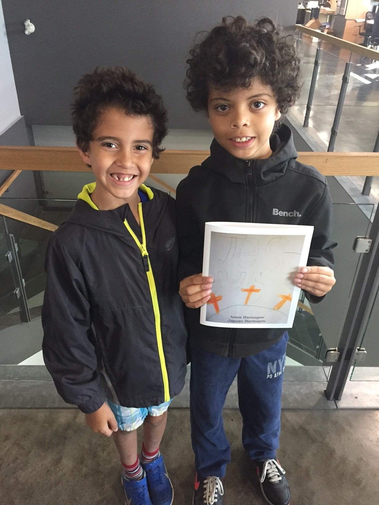 This is Jaguan (left) and Amos (right) at the printing house looking at their book proof.
