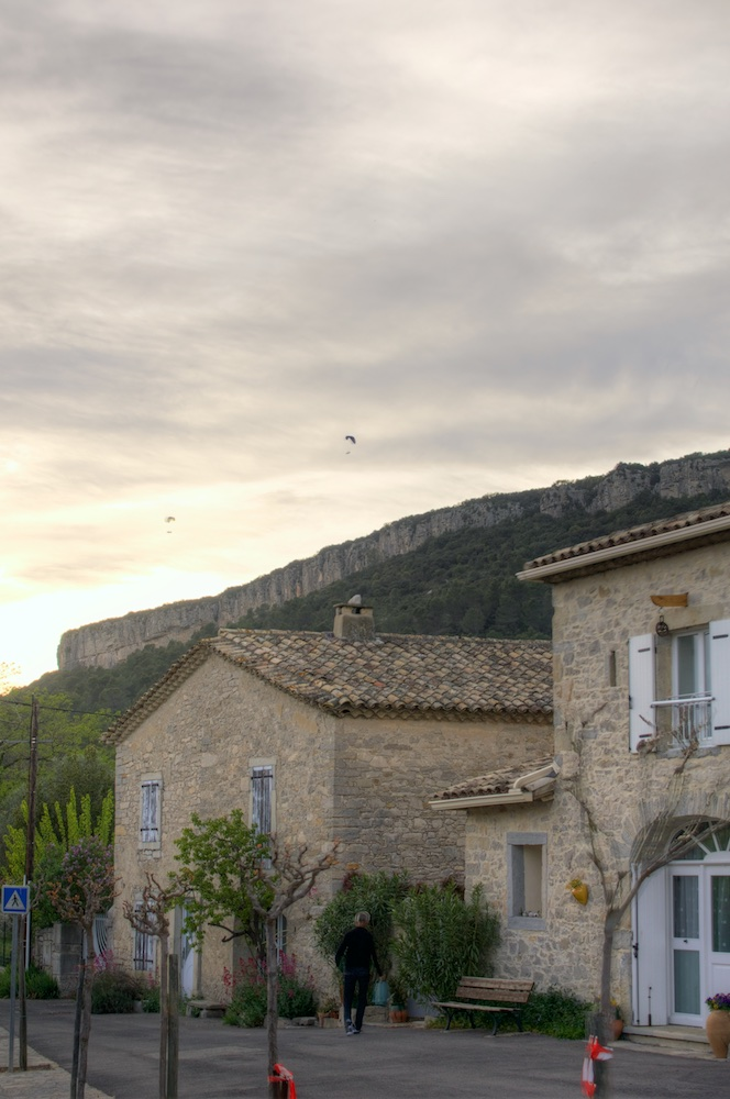 Claret with paragliders above the cliff, France