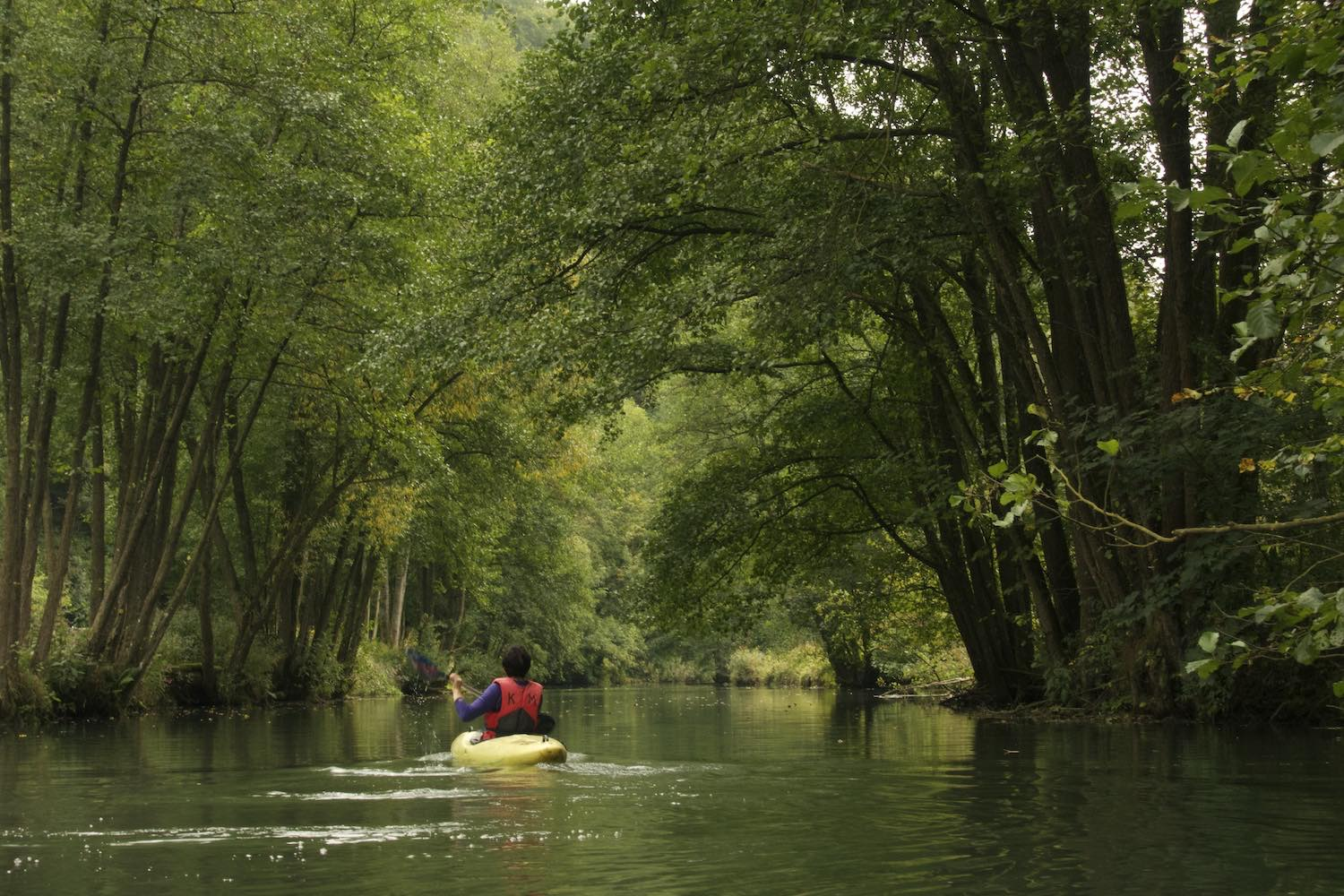 Paddling down the Wiesent River while climbing in Frankenjura, Germany