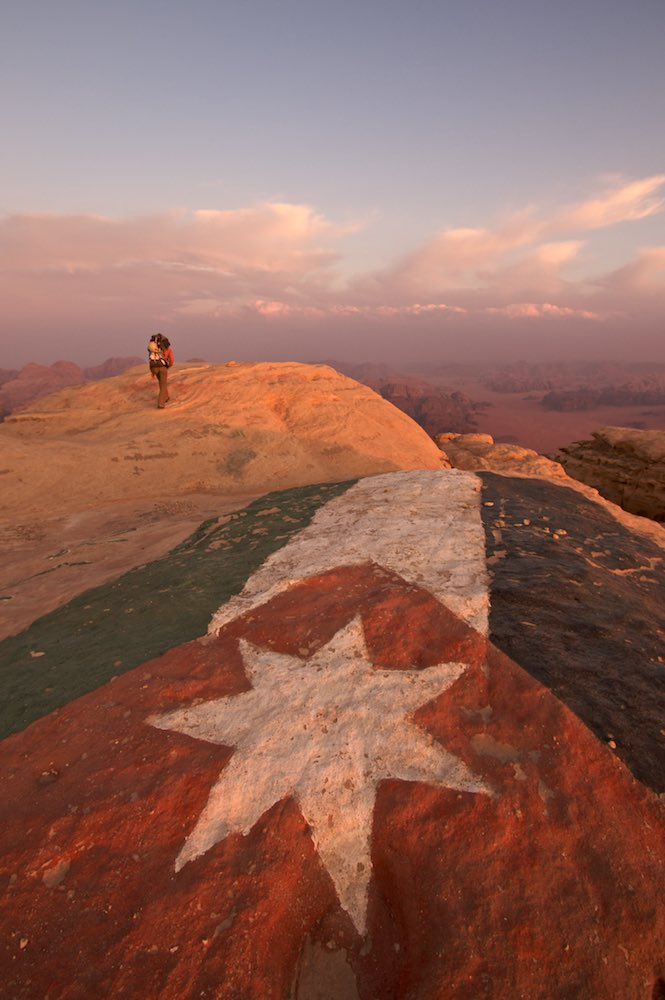 The flag of Jordan painted on the summit of Jebel Rum