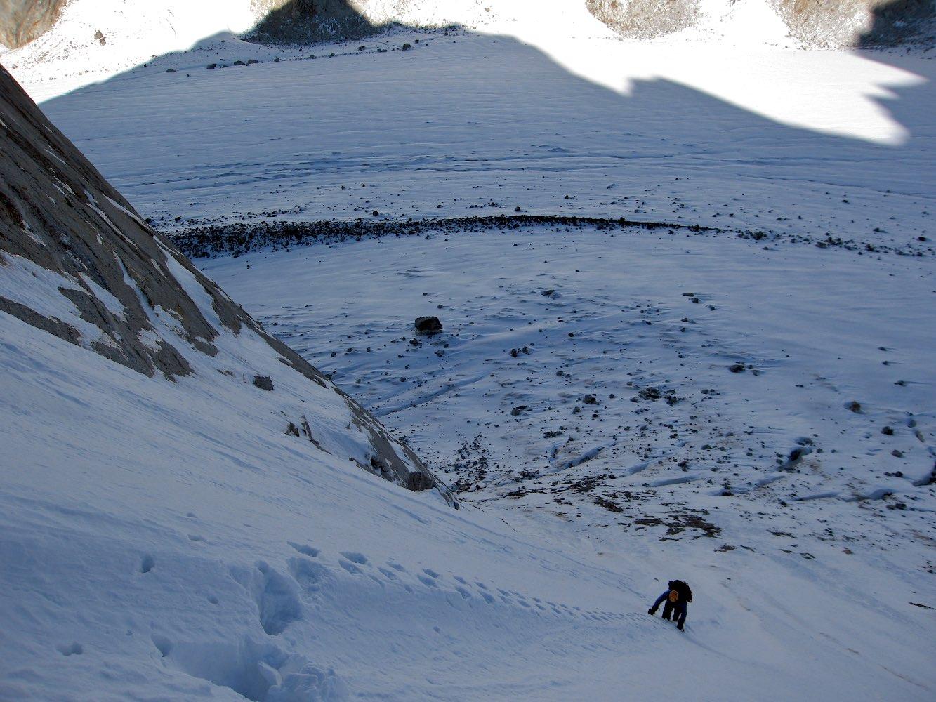 Long cold couloir ascent to gain Triple Crown's north-west ridge