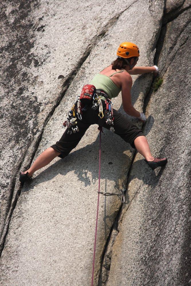 Tash leading 'Crescent Crack' (5.10d), Lower Malamute