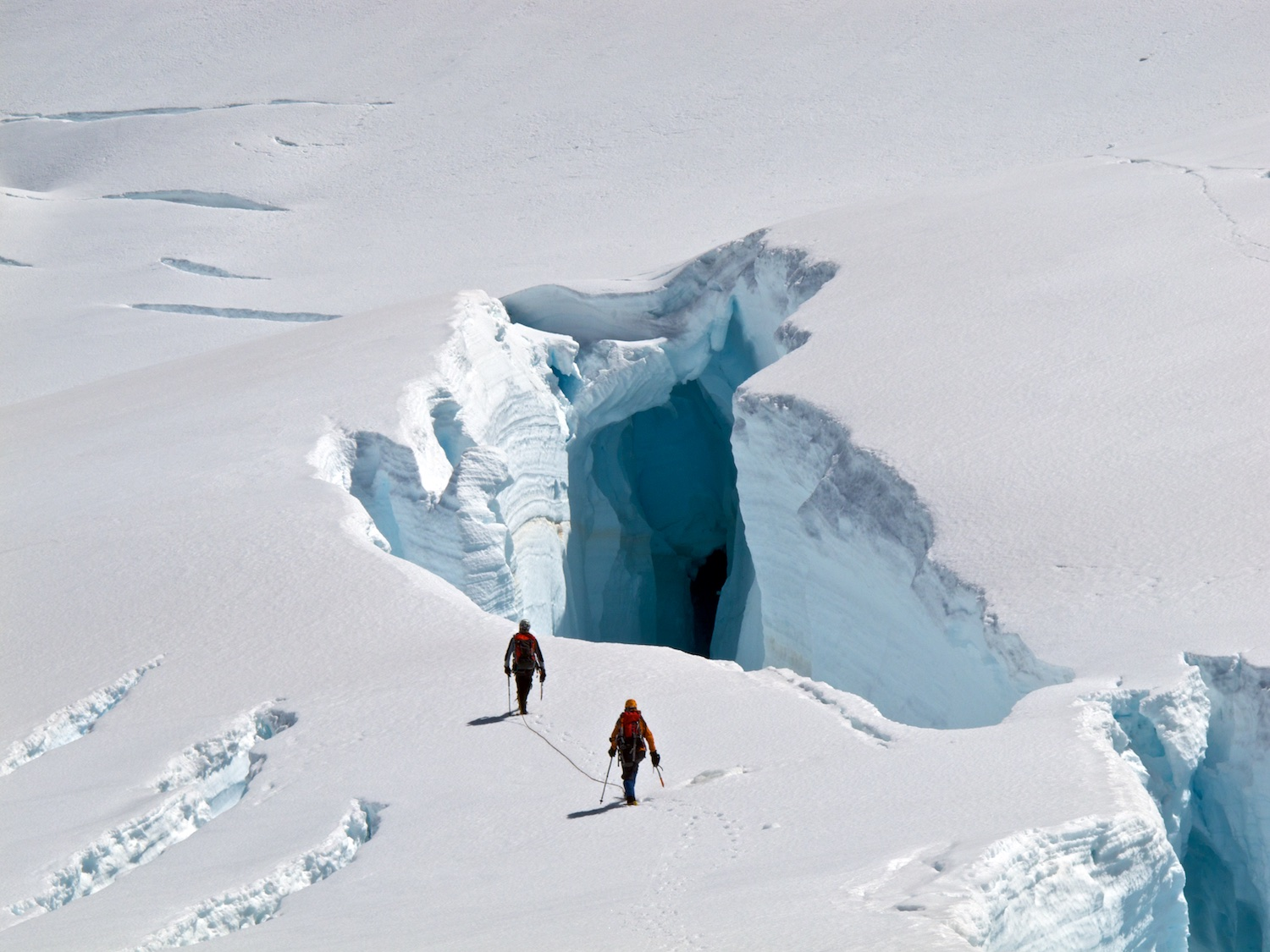 Marty and Vanessa dwarfed by a huge crevasse in the Hooker