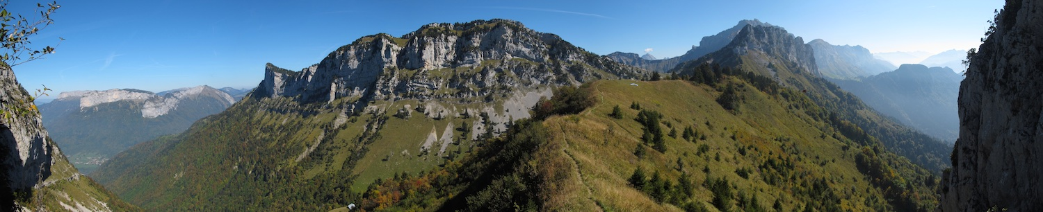 The Col des Frettes - the launch site is the grassy slope facing to the right with a paraglider laid out just visible