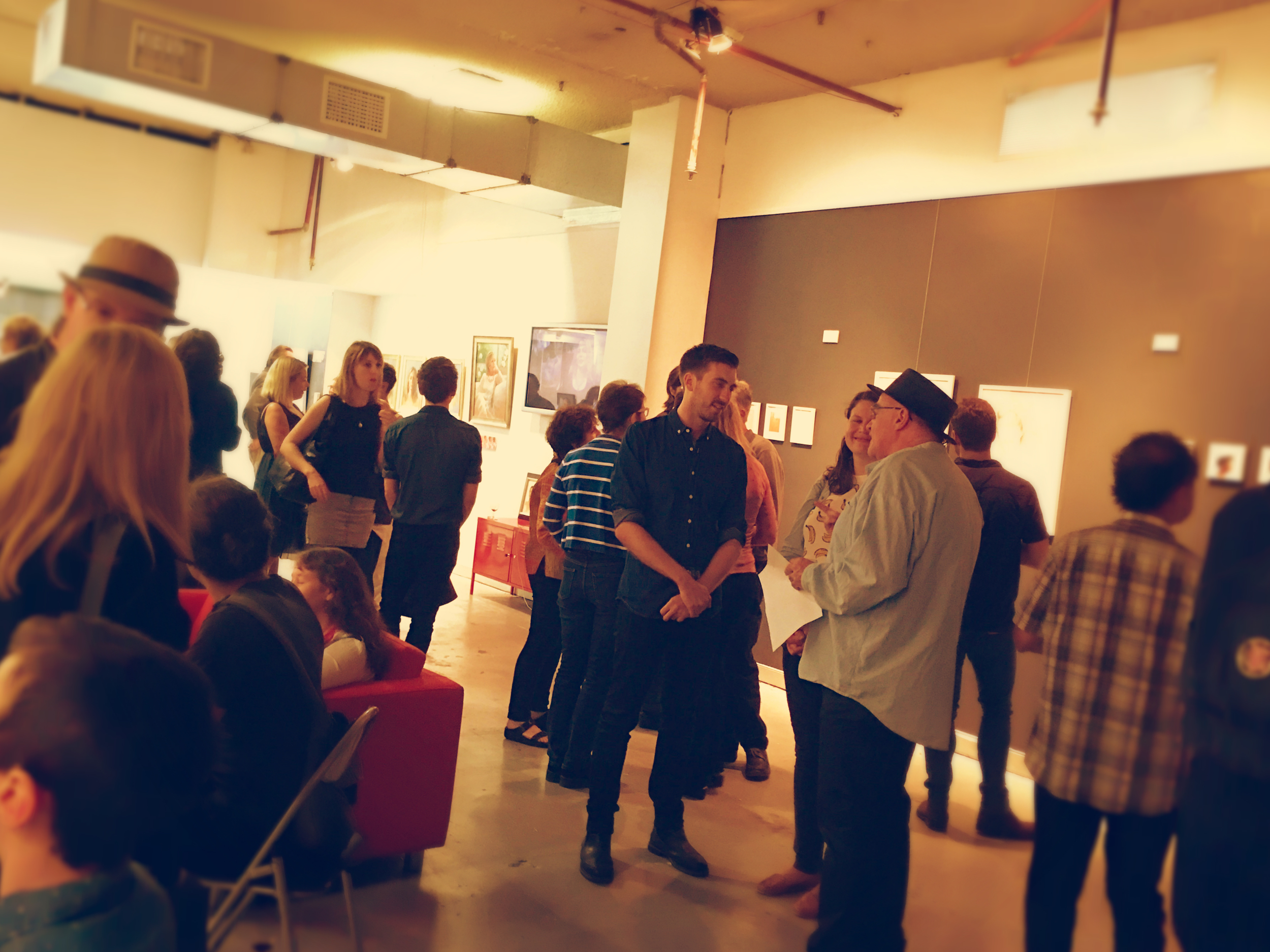 Crowds gathering at Project 504 gallery.