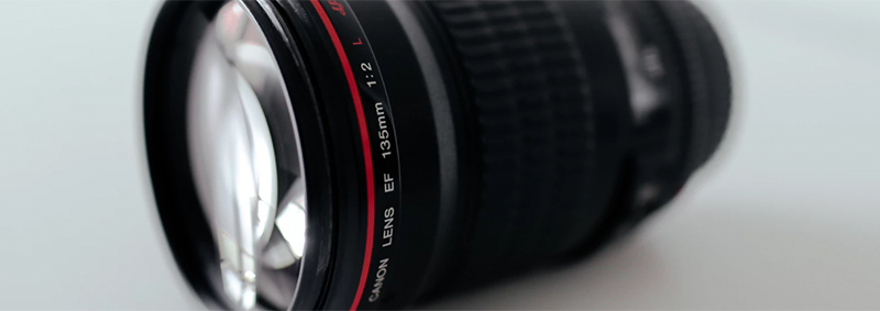 With this lens you can see that it has a focal length of 135mm, and a largest aperture of f2