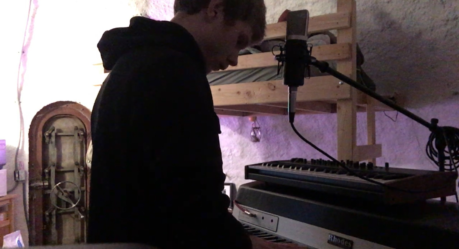 Max sketching out ideas on the band's Fender Rhodes.