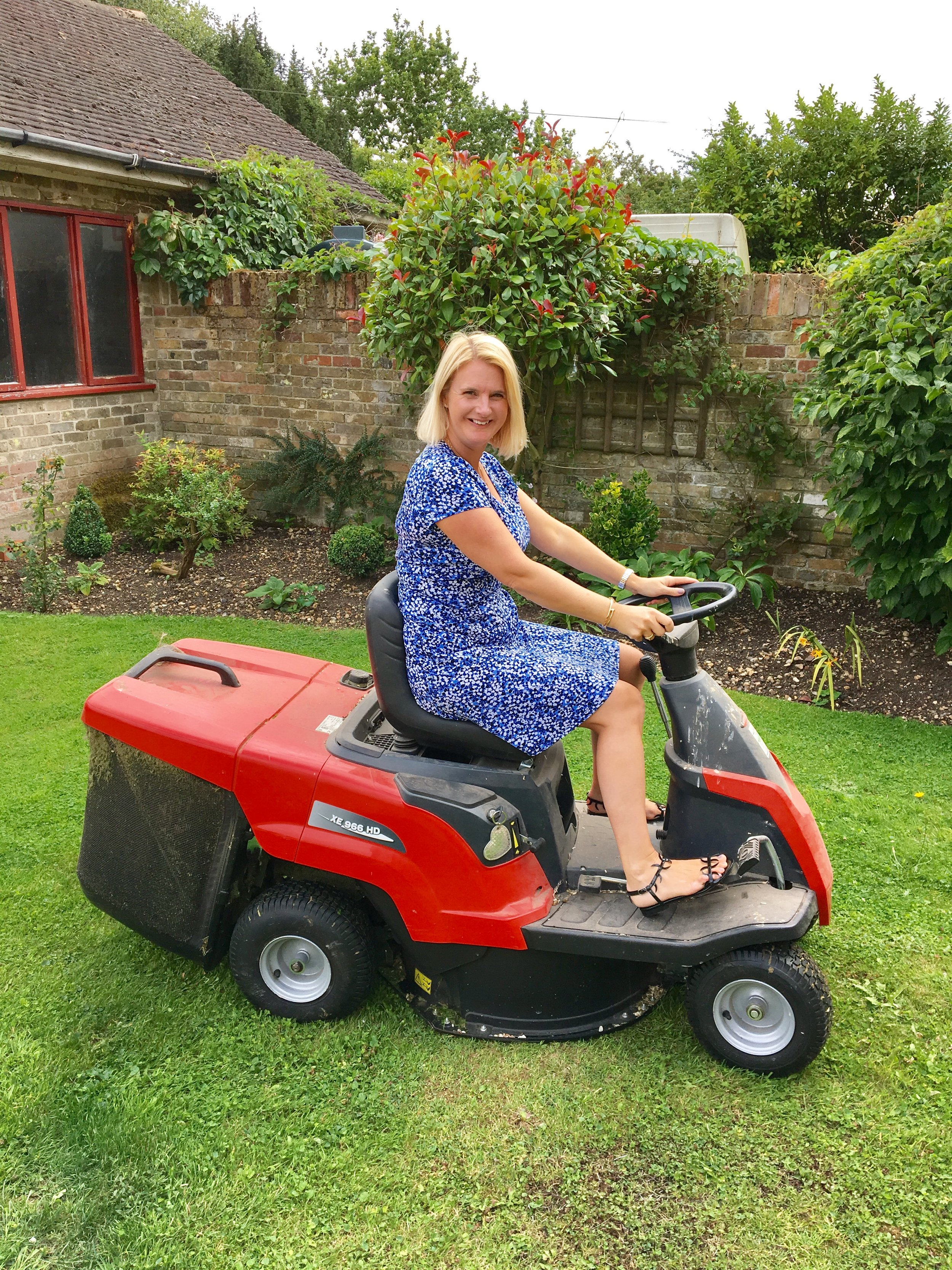 Dress From Micheal Kors, Shoes From Manolo Blahnik, Mower for my birthday last year, C knows how to treat a lady! Hahahahahahah.  I'm more Margot from The Good Life than Barbara when it comes to gardening, but at least I get it done.