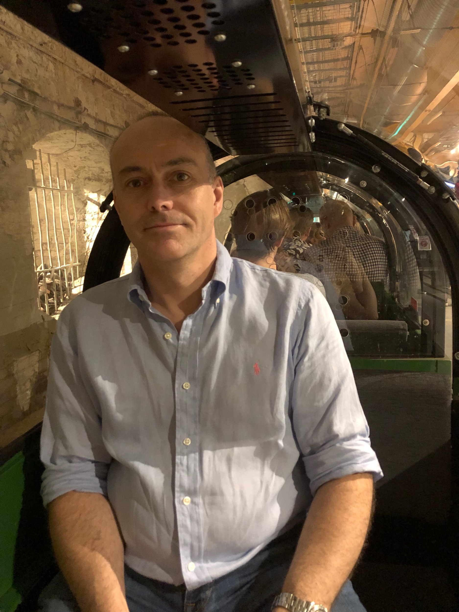 Inside the tiny tube trains that now serve this tunnel.